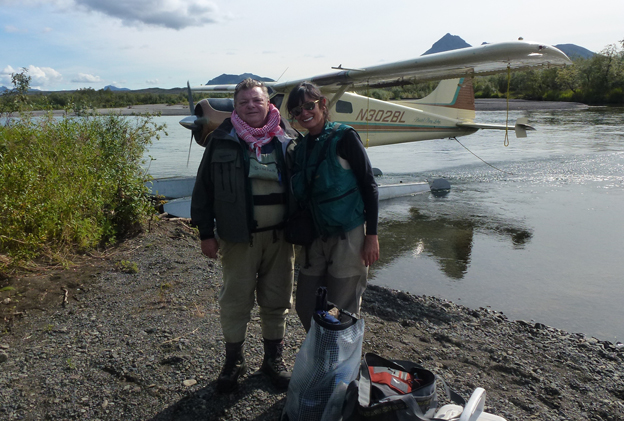 Two customers on the banks in Alaska fly fishing for salmon