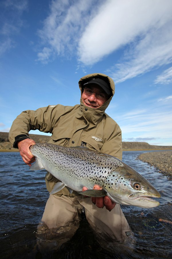 customer holding up a really nice sea trout from argentina