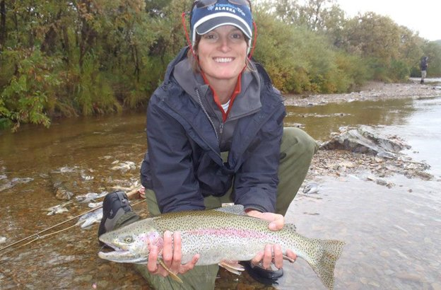 lady customer with a cracking rainbow trout fly fishing alaska