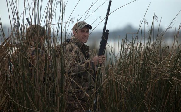 hunters standing in reeds Father & Son Visit Argentina Report