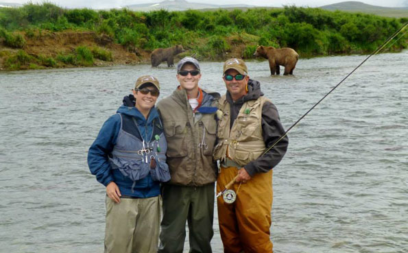 a team picture on the river bank at our no see um lodge report alaska
