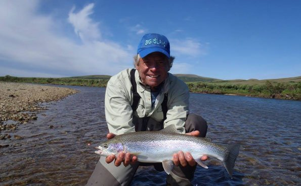 customer holds an amazing rainbow trout no see um lodge alaska