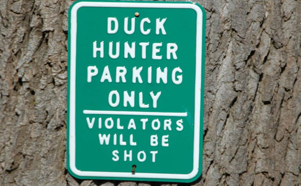 a funny parking sign Argentina shooting report