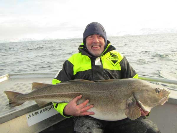Man cradling his huge skrei cod from Norway Fishing Report