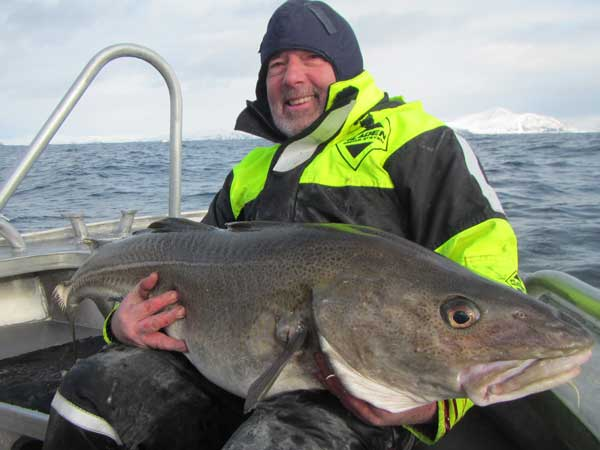 He is so very happy with his biggest cod Norway Fishing Report