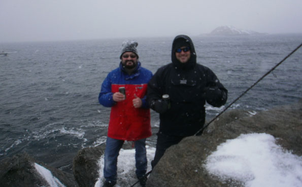 Two friends standing at the shore of Soroya Norway Fishing Report