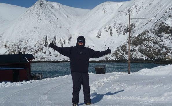 Man standing in deep snow Norway Fishing Report