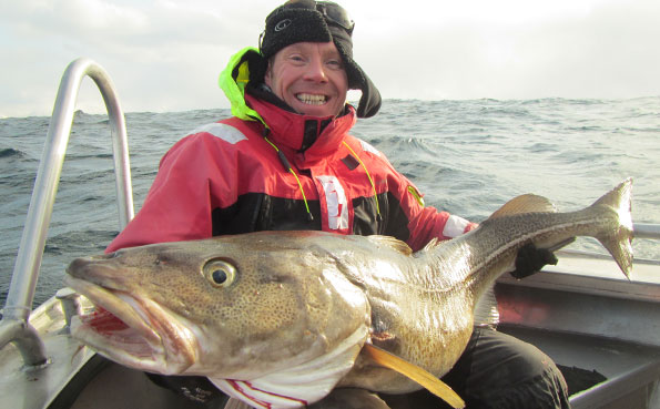 He is one happy man with his cod fishing Norway fishing report