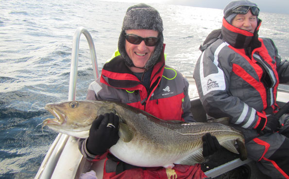 Two friends fishing at Soroya Norway fishing report