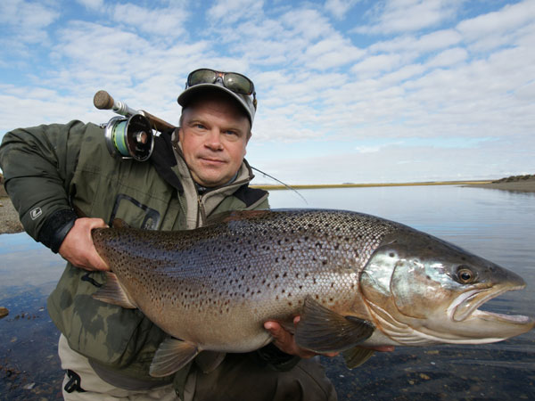 customer holding a cracking sea trout caught fishing at Las Buitreras Argentina