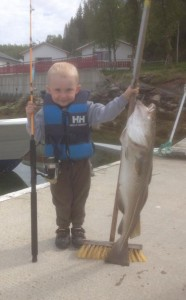 Young lad with a cod the same size as him Fishing Report Norway