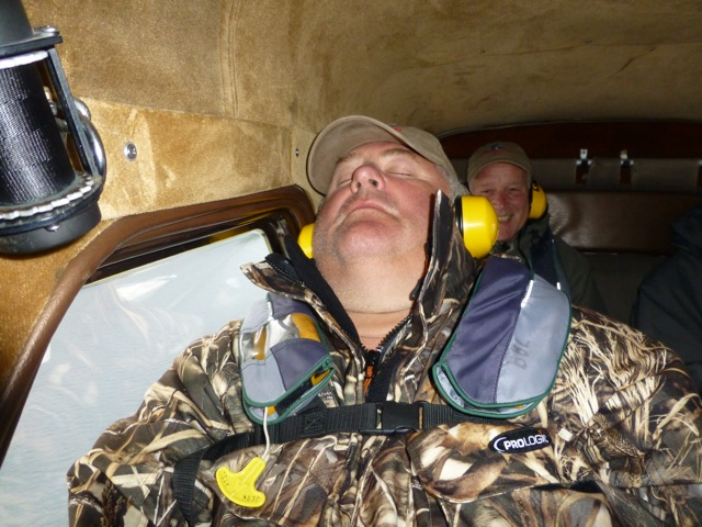 customer sleeping as the fly fishing for kings is too much for him