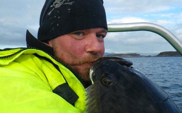 Man kissing Halibut Norway fishing report from Lofoten