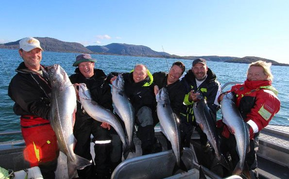 Norway Fishing Report of a large group of fisherman catching coalfish
