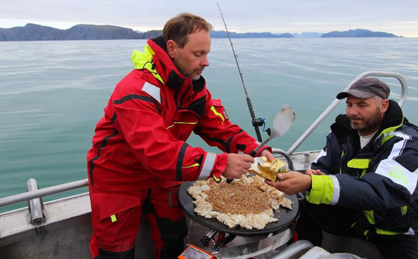 Cooking dinner on the boat Norway Fishing Report