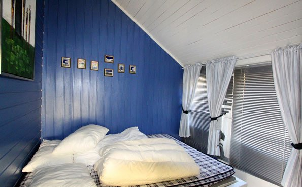 Typical bedroom in a cabin Fishing Report Norway