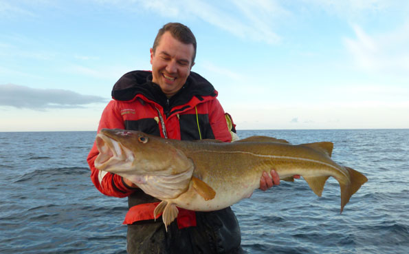 Guide Paul hooks and lands monster Cod fishing report Norway