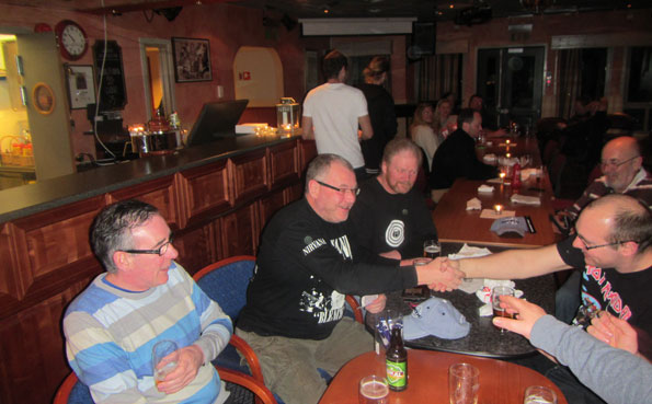 Men drinking at Soroya Norway fishing report