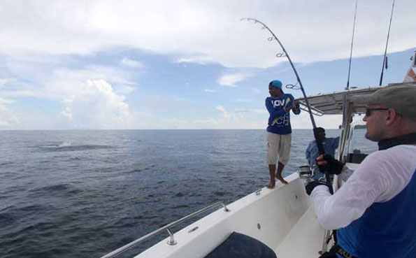 his rod is bent in to his fish Fishing Report Andaman