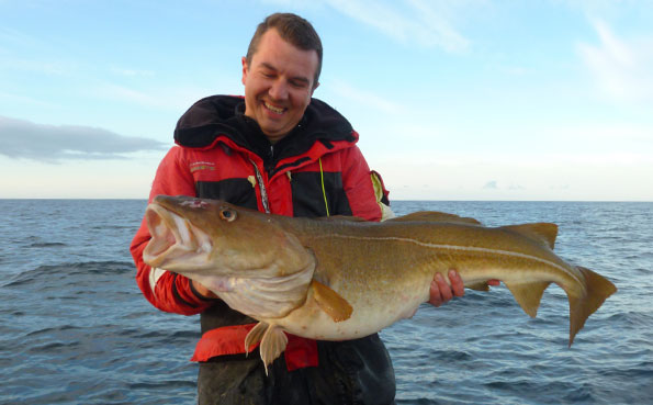 Paul with another great looking Cod for his fishing report norway