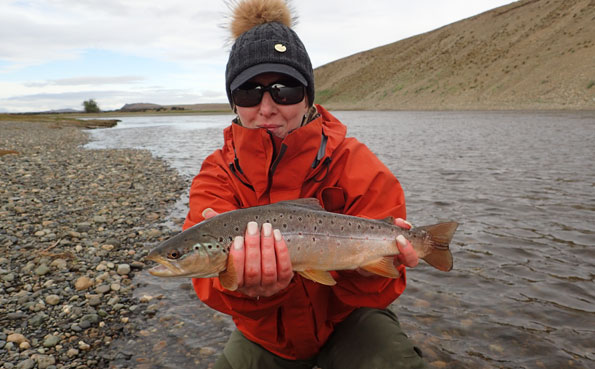 tracey with a small brown trout in argentina