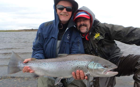 christer and lawson holding a nice sea trout