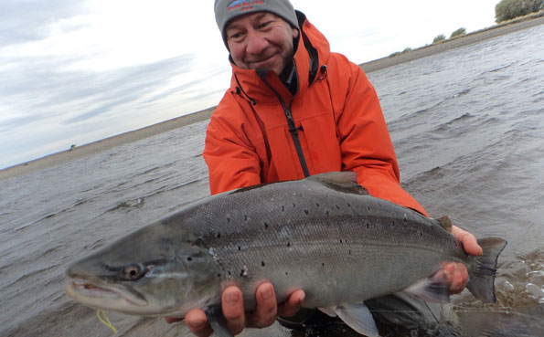 kevin poses with sea trout