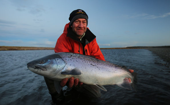 kevin with a big sea trout late at night