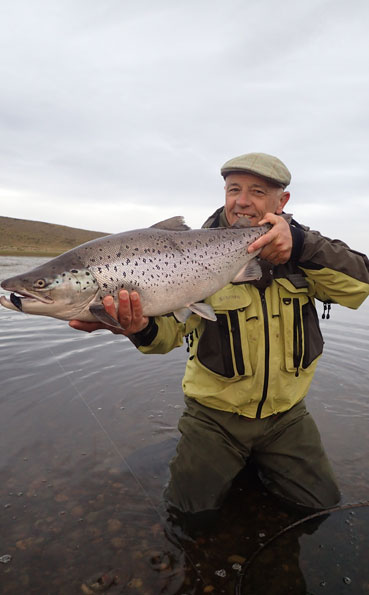peter collingsworth with a fat hen sea trout in argentina