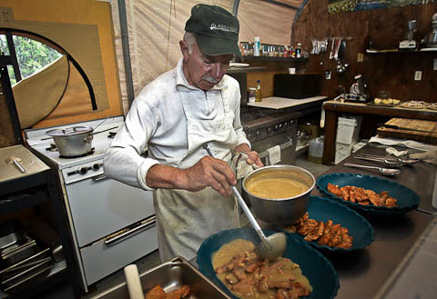 the chef at alaska west cooking evening meal Alaska West Lodge New destination