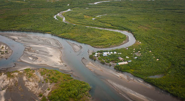 an ariel view of the tented alaska west camp in full swing