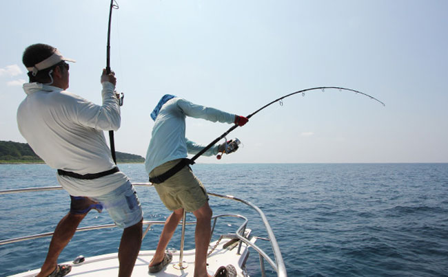 Two anglers battling their GT's Andaman Fishing Report