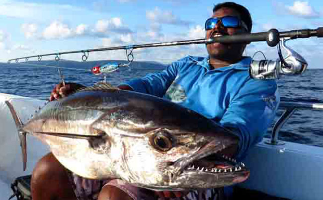 Angler holding up a Andaman Fishing Report of a Dogtooth tuna