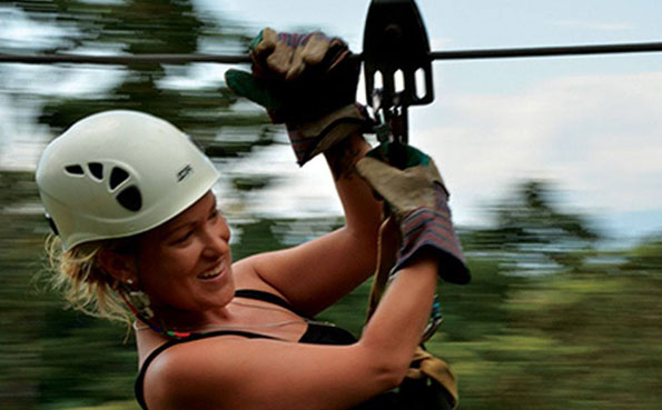 A Lady zip lining Costa Rica Fishing Report