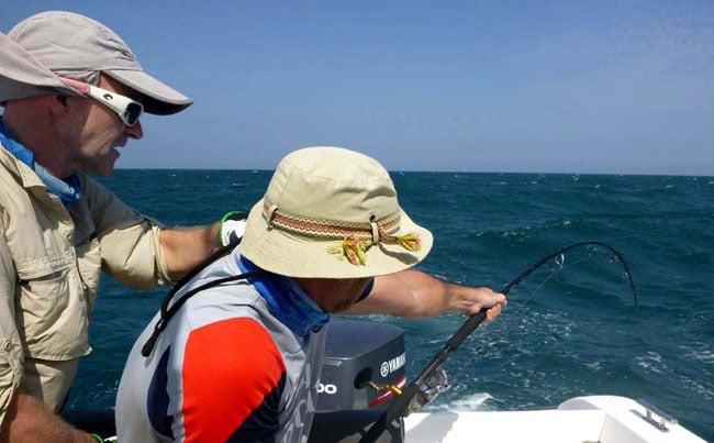 He is taking the strain of a massive fish Fishing Report Sri Lanka