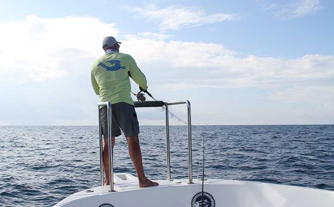 Casting from the boat with his biggest popper Sri Lanka Fishing Report