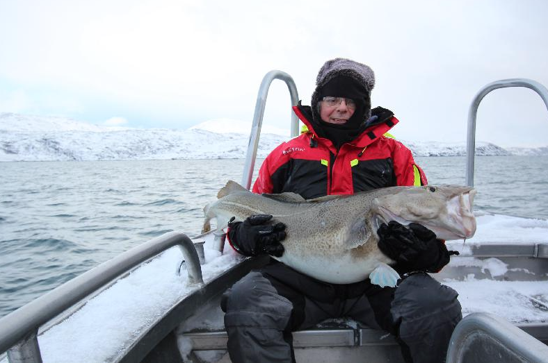 He looks very cold holding his Cod fishing report norway