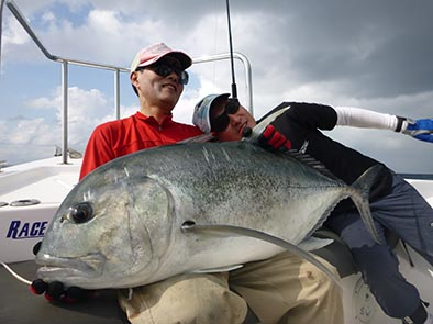 Two people holding up massive GT Sri Lanka Fishing Report