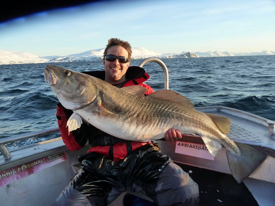 He is one happy boy holding his cod up Fishing Report Norway