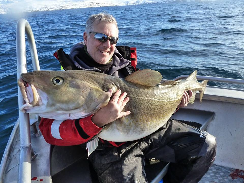 Man holding a huge cod in our Fishing Report Norway