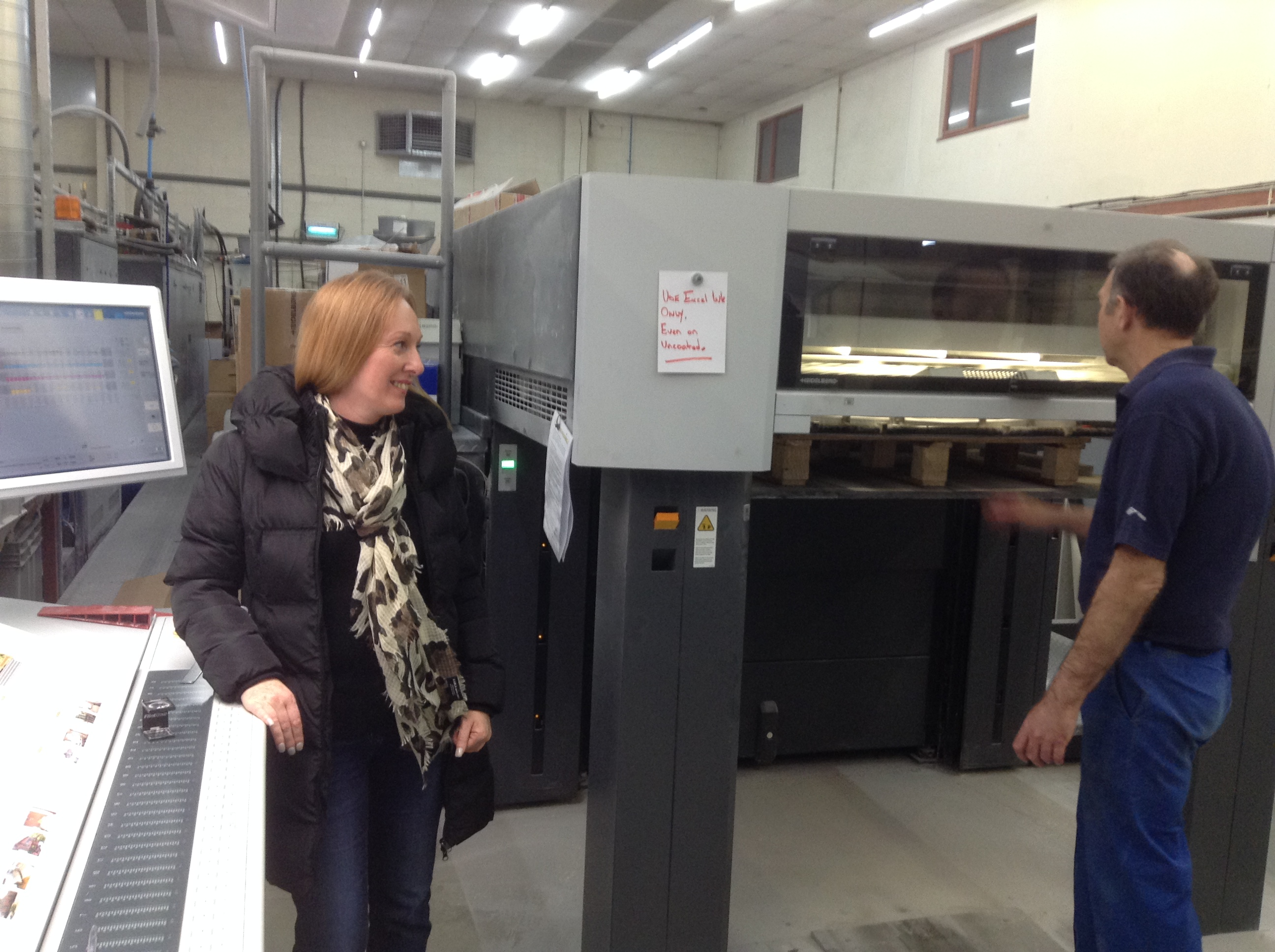Pages of our brochure being printed