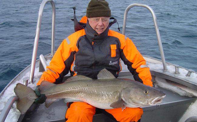 David holding his biggest Cod Norway Fishing Report