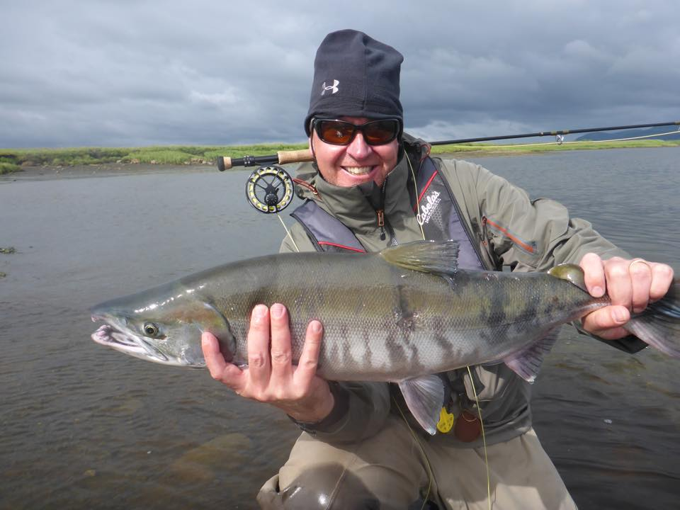 Hosted Bristol Bay Lodge Report a fresh female chum salmon being held up for the camera, fly fishing for pacific salmon