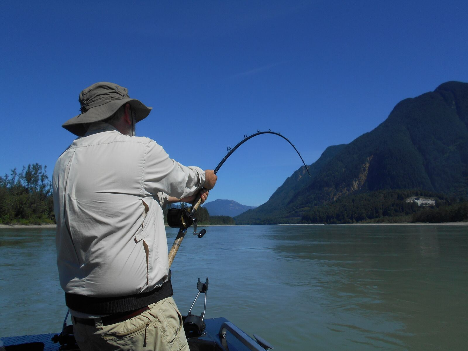 A man holding on to his fishing rod Fishing Report Canada