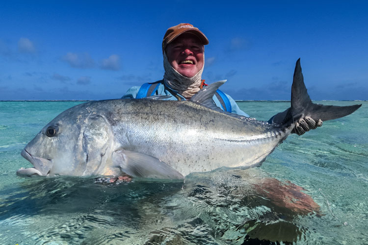 A customer looks very happy holding out his prize GT from Farquhar Seychelles