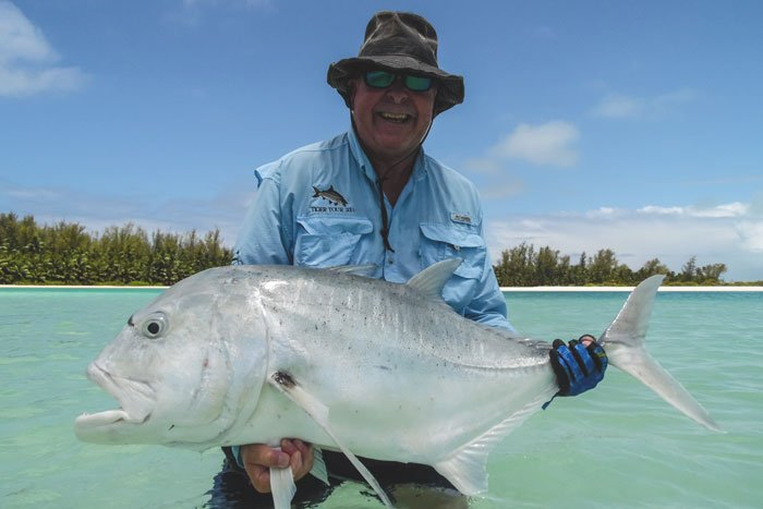 Customer with another huge GT caught fly fishing on Farquhar in the Seychelles