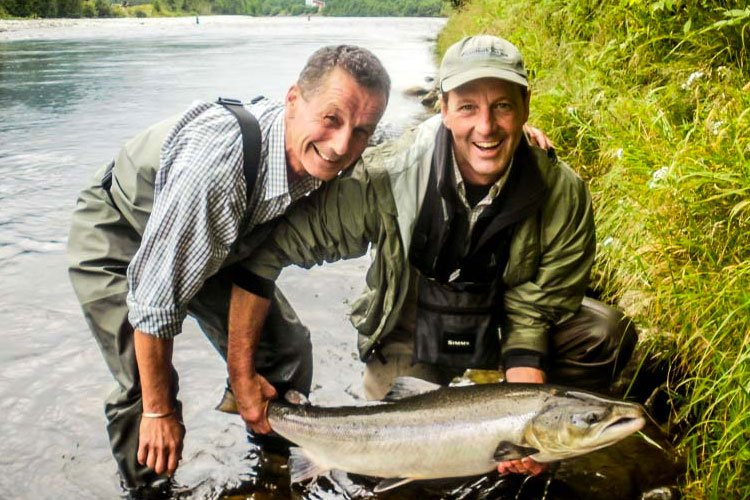 Two happy anglers with an Atlantic Salmon