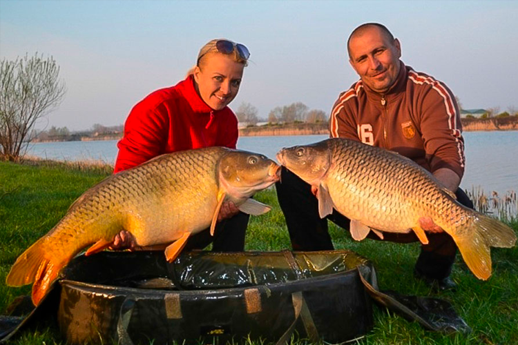 A couple of anglers and a couple of carp