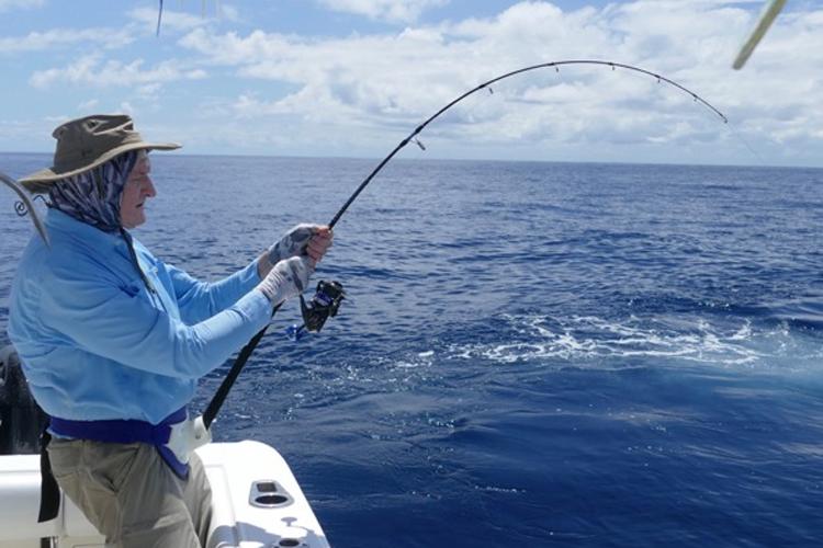 Angler playing a yellowfin tuna