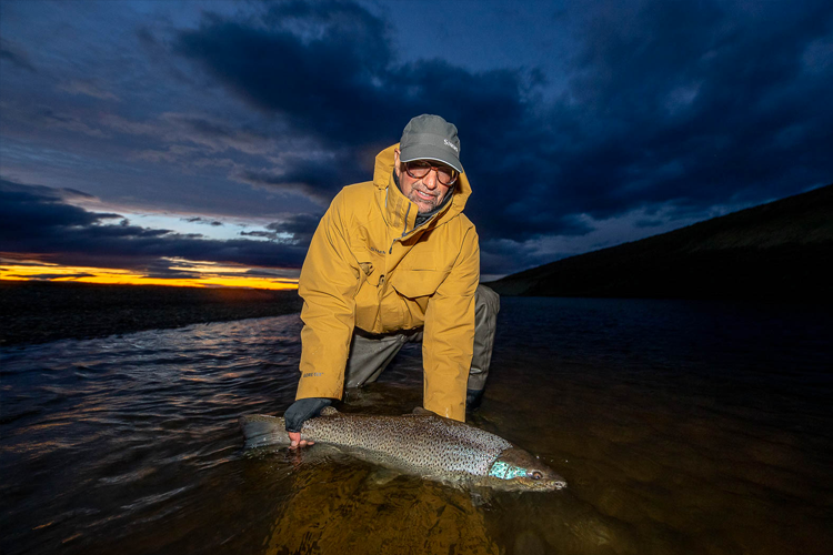 Landing a Sea Trout before Dusk